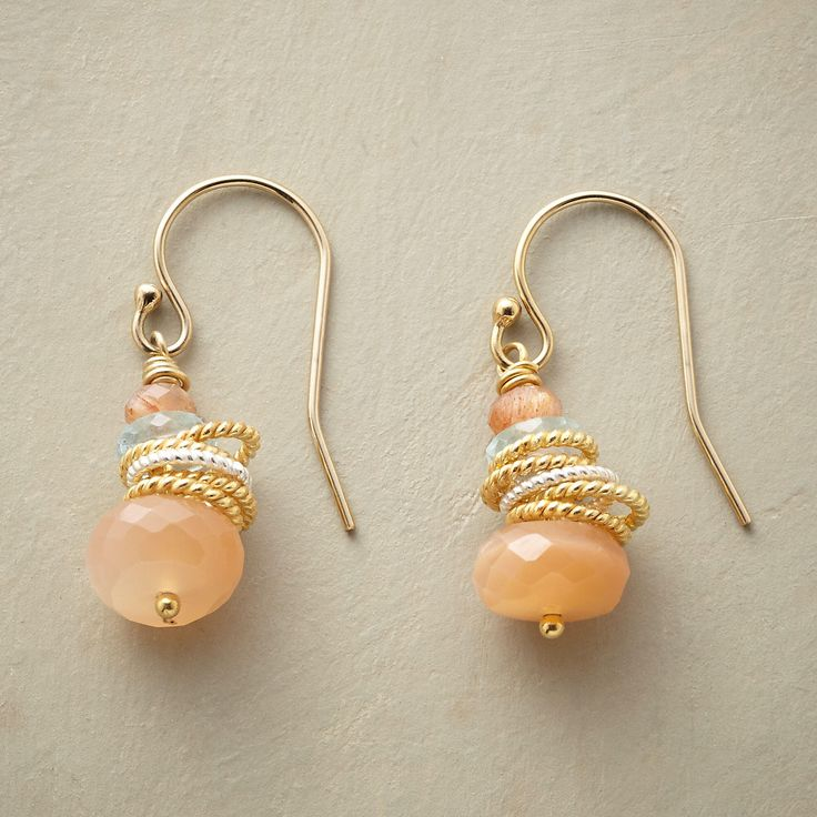 "CIRQUE EARRINGS -- A pair of sterling, 14kt and gemstone earrings, wherein roped rings of sterling silver and 14kt gold filled tumble among peach moonstones and aquamarines. 14kt gold filled French wires. Exclusive. Handmade in USA. 1""L."