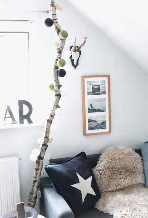 Oscar 8 år - birkegren brugt som 'fod' til den fine Happy Lights lyskæde - Photo by Mathilde Andersson