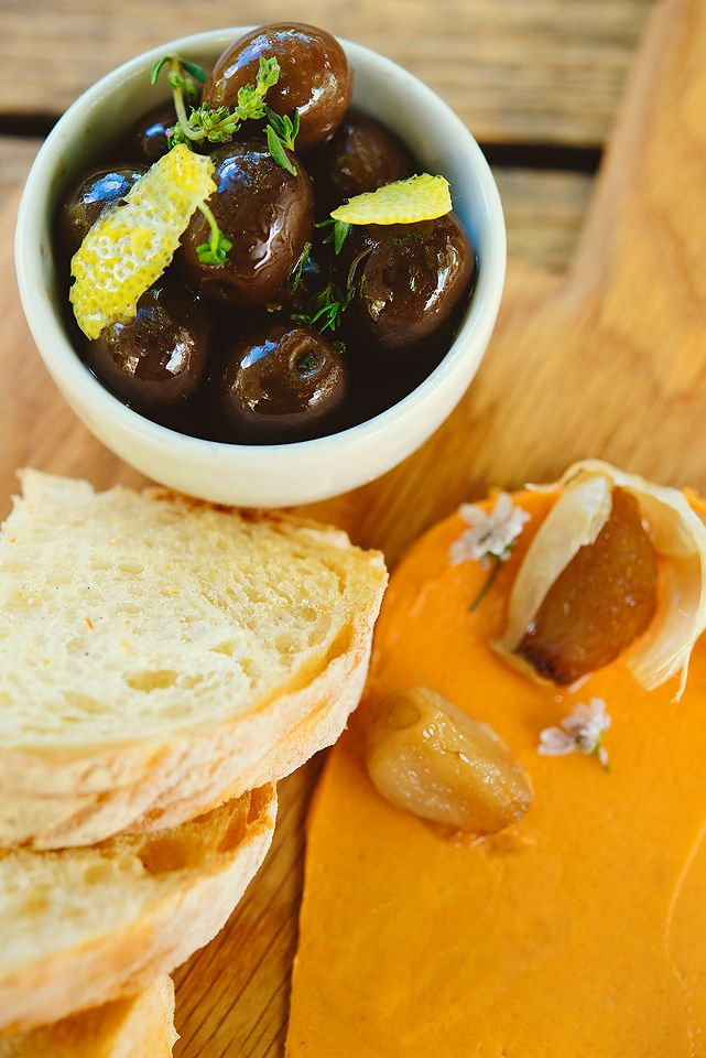 Mediterranean olives, roasted garlic and fresh ciabatta at Peddlars & Co.