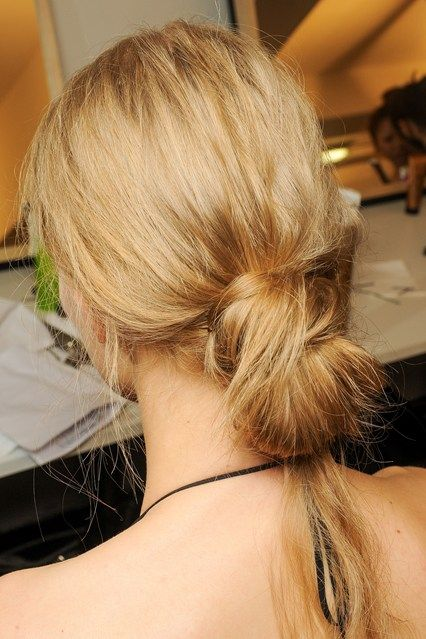 MarniThe hair at Marni was inspired by the loose, messy knots worn by female employees in the Marni offices.