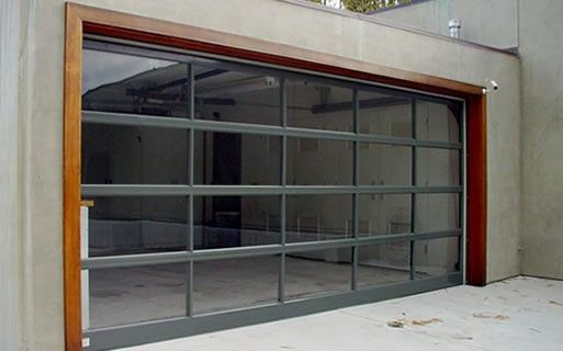 Great glass and steel garage door. something like this for the backyard with a door to access the house.