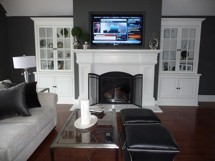 Installed new zero clearance fireplace unit, framed wall enclosure floor to ceiling with recessed TV niche built in, built custom mantle and flanking cabinetry