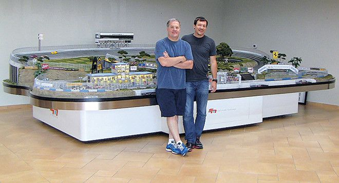 TEXAS-SIZED. Jeff Mosing (RIGHT) with Slot Mods USA founder David Beattie in front of Dream Weaver Raceway, putting the track's imposing 12ft x 20ft layout and recreation of Daytona's banked start/finish straight into perspective.