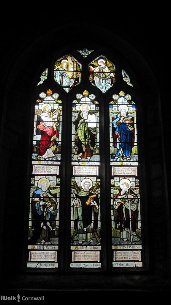 Stained glass inside the Church of St James the Great at St Kew, Cornwall