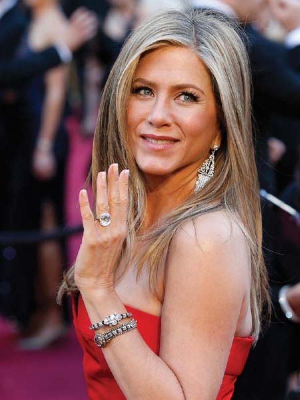 Jennifer AnistonAniston displayed a pair of stunning Fred Leighton chandelier earrings. However, we couldn't get our eyes off a certain diamond she sported on her ring finger.