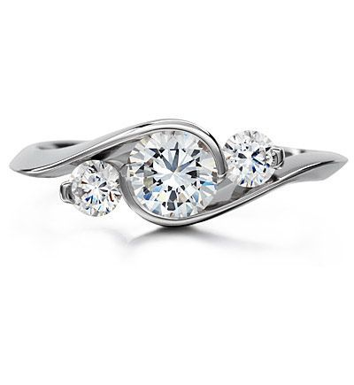 LOVE this three stone engagement ring, especially with the swirl effect