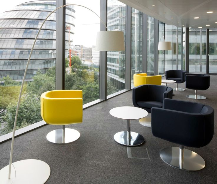 Creating communal spaces and breakout areas in the prime spots of an office fit out has become a key workplace trend, maximising these desirable locations so that everyone can reap the benefit. This informal meeting or breakout space next to full height, wrap-around windows, has flexible seating in neutral tones and pops of yellow to add colour, contrast and branding.