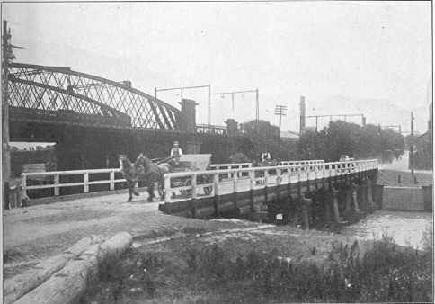 PH 9540. Temporary bridge over the Yarra during construction of the new Church Street bridge, c.1921.