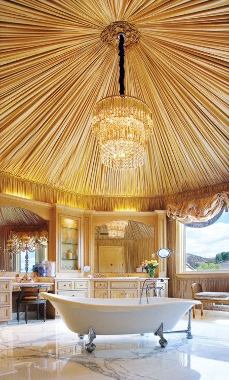 Amazing canopy... and chandelier over the tub?  Cool room but I'd move the tub to another area.