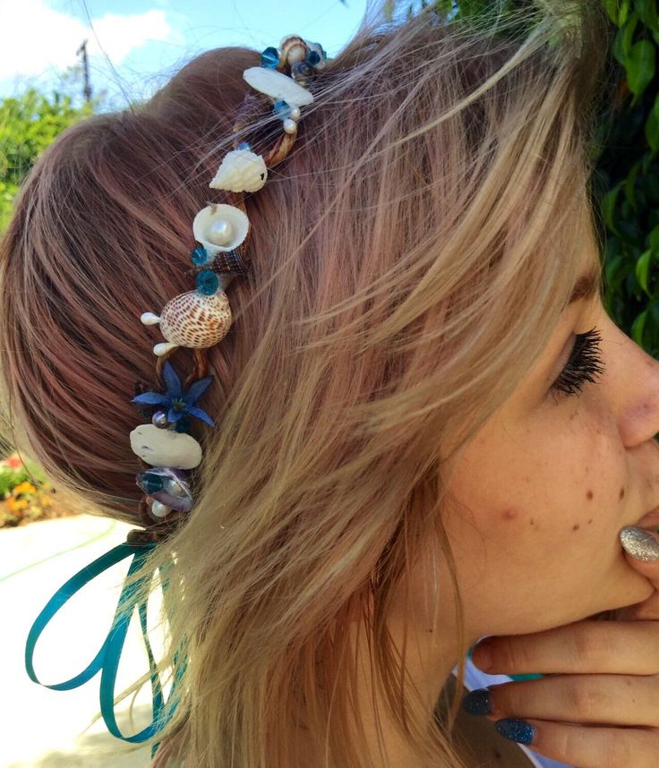 A personal favorite from my Etsy shop https://www.etsy.com/listing/242500604/seashell-crown-halo-headband-seashore