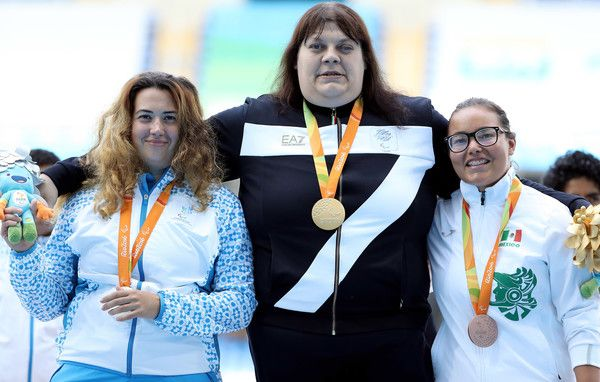 (L to R) Silver medalist Safiya Burkhanova of Uzbekistan, Gold medalist Assunta Legnante of Italy and Bronze medalist Rebeca Valenzuela Alvarez of Mexico pose for photographs on the podium at the medal ceremony for the Women's Shot Put - F12 on day 7 of the Rio 2016 Paralympic Games at the Olympic Stadium on September 14, 2016 in Rio de Janeiro, Brazil.