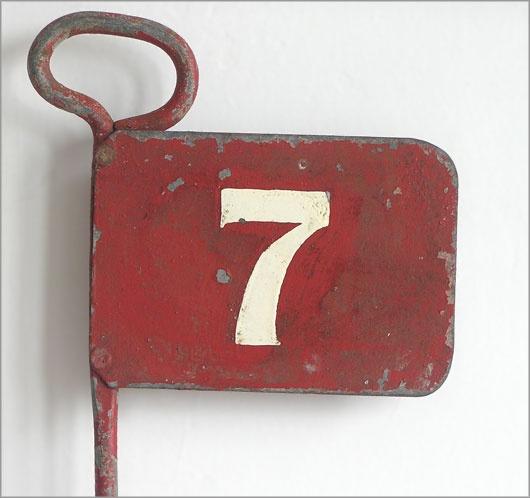 vintage metal golfing marker flag. number '7', pattisson's, c.1930s.