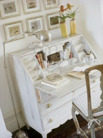 white and chrome painted writing bureau