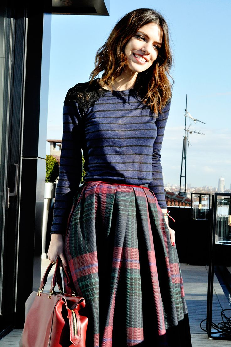 I love this plaid skirt, very flattering. It could be paired with a simple crop top in black or a red sweater.