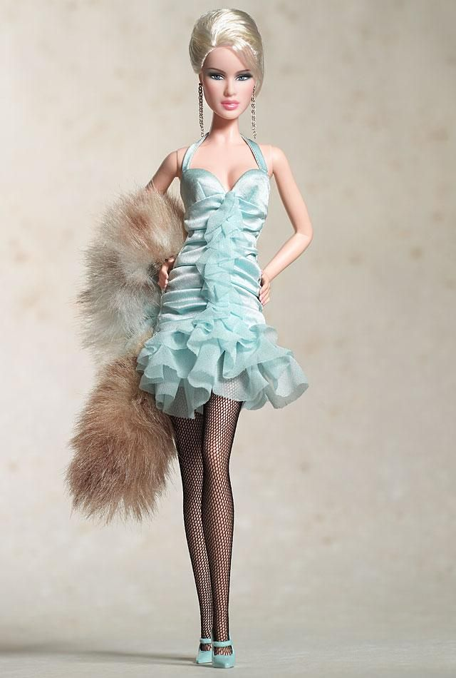 Daria™ Celebutante™ doll wears a chic city outfit, perfect for the model on the go. Light blue polyester charmeuse dress, featuring ruffles galore, is worn over a chiffon and tricot petticoat. A faux lynx fur plush stole lined with matching charmeuse warms her shoulders. Black mesh hose and mary jane pumps complete the ensemble.