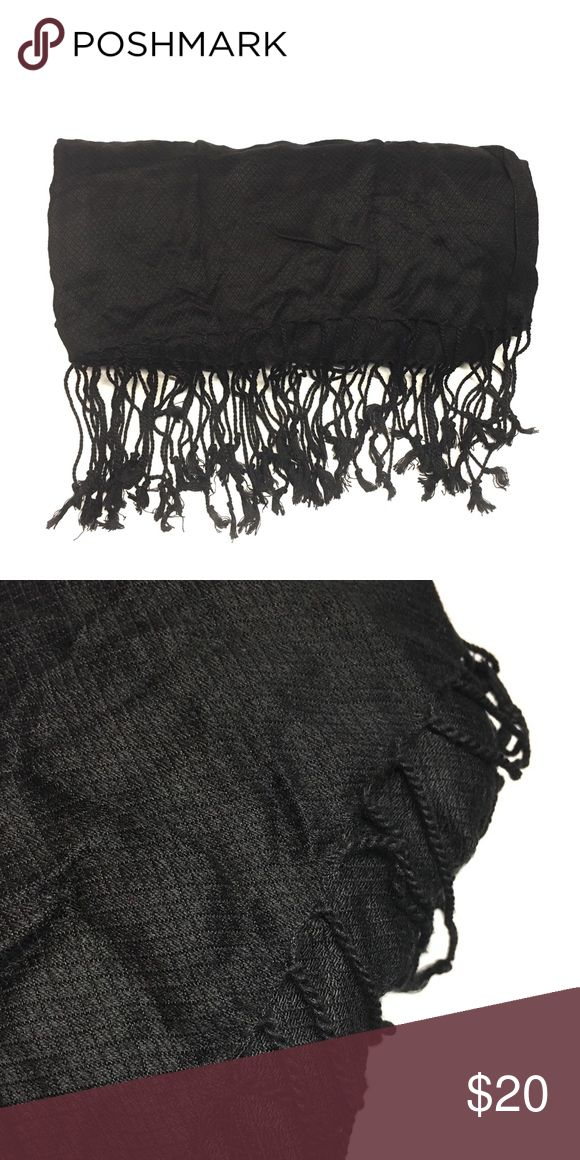 Black Fringe Tassel Scarf · Black scarf with fringe tassels. Lightweight and smooth material. Great for fall layering. Good used condition. Comment for specific questions.    · These are photos of the actual item. Please review photos for flaws or signs of wear. I try my best to showcase and represent the true product. Accessories Scarves & Wraps