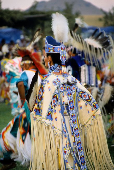 Ladies traditional Pow Wow dancer dressed in white brain tanned leather regalia with beautiful beaded strips and headdress crown at the Chippewa-Cree pow wow on the Rocky Boy Indian Reservation, Montana