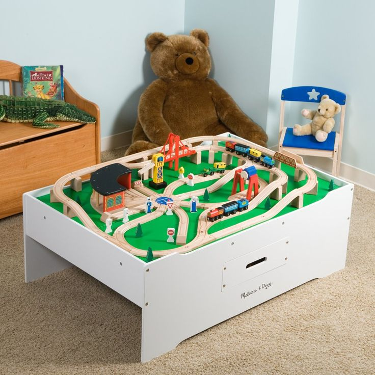 Melissa and Doug Train Table with Optional Railway Set - Unique in its concept and style, this high-sided children's work table comes with a cool wooden train set that can be arranged in many different ways....