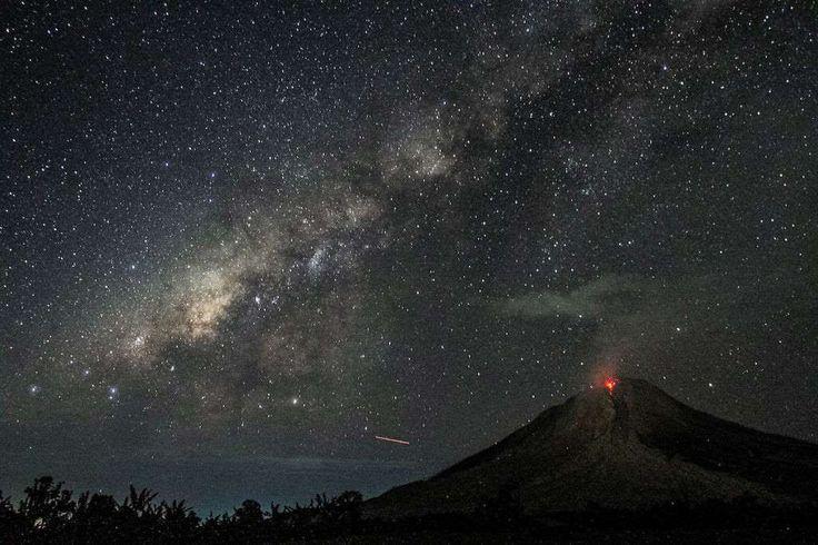 Sinabung Volcano erupts under the Milky Way in Karo, Indonesia // August 2, 2017 - Getty