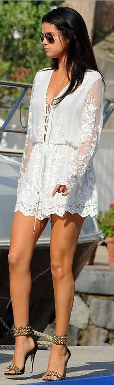 Selena Gomez, white lace romper and black ankle strap sandals. I love this outfit!: