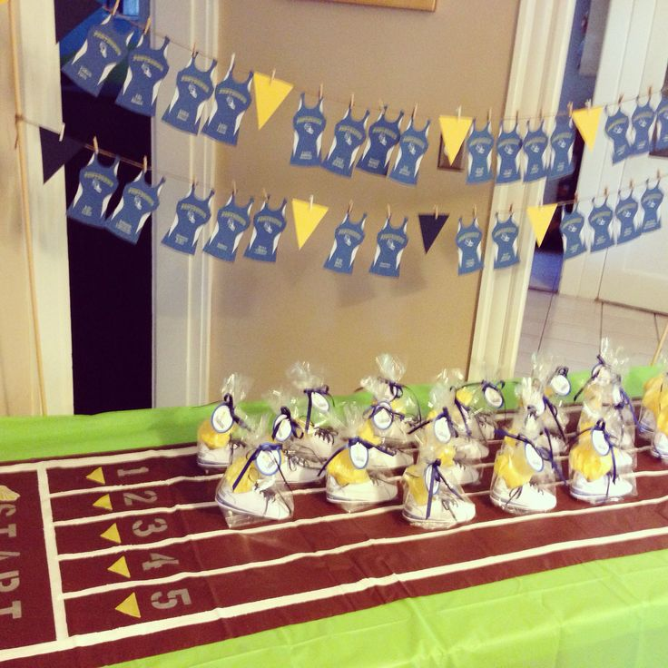 Track and field favor table    Paper sneakers and paper track jersey with athletes names