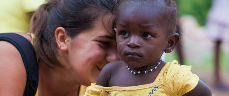 volunteer with a child to helping abroad