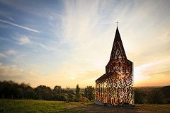 The Belgian architects duo Gijs Van Vaerenbergh (BE) built a see-through church for Borgloon. Reading Between the Lines is 10 metres high and consists of 100 stacked layers of steel plate in the shape of a church of Loon. The construction weighs a whopping 30 tons. The special way of construction makes the landscape always visible throughout the church, from far away and up-close. The church is therefore present but also absent in the landscape.  Practical info  On display: . ...
