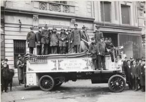 The first motorized apparatus of the FDNY was a 1909 Knox high-pressure hose wagon, shown here in front of Engine Company No. 72 at 22 East 12th Street (today the Cinema Village theater). This hose wagon was one of the first three firefighting vehicles to simultaneously arrive on the scene of the Triangle Shirtwaist fire on March 25, 1911. Photo, Museum of the City of New York Collections. High-Pressure Hose Wagon, FDNY, 1910