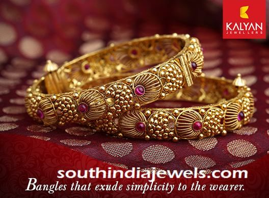Kalyan Jewellers antique gold bangle embellished with rubies. For inquiries please contact 91 487 2437100.