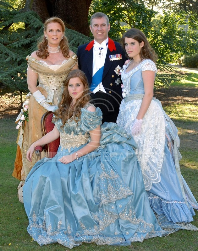 Prince Andrew and family pose in costume for Princess Beatrice's 18th birthday party.