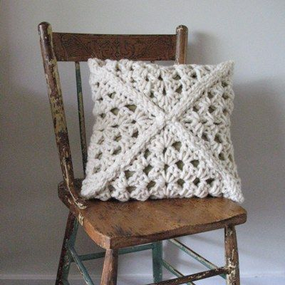 crochet cushion made of 4 granny squares.    Can't find the pattern but its easy to follow from the picture.