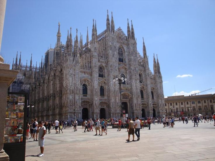 Photo about Duomo`s facade on a sunny day - July 2017 - Milan - Italy. Image of 2017, people, main - 111277887