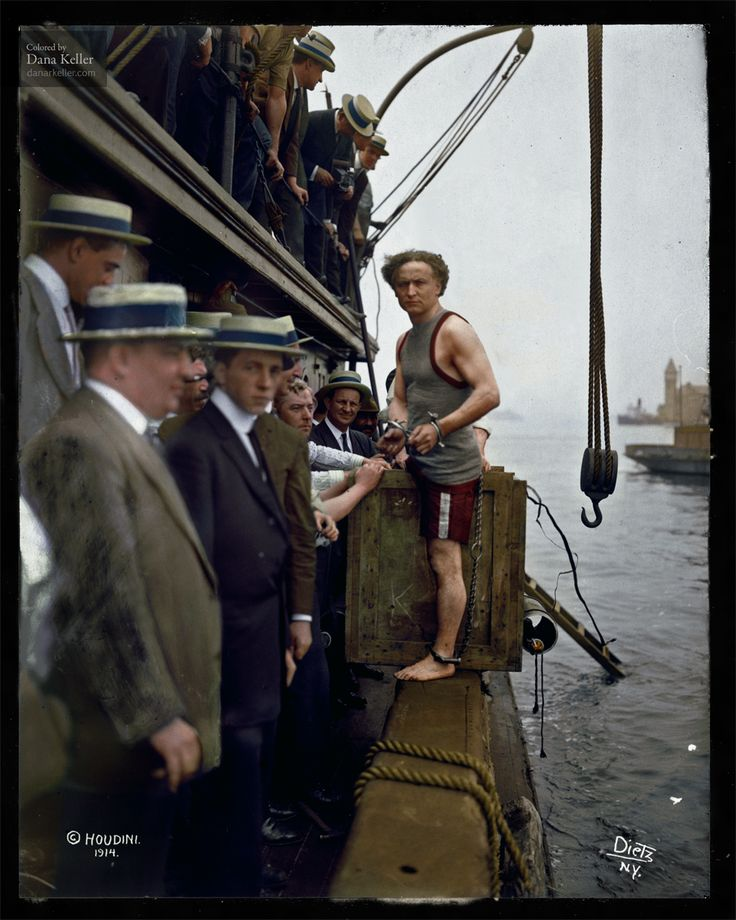 Harry Houdini steps into a crate at New York Harbor as part of an escape stunt, July 7, 1912.