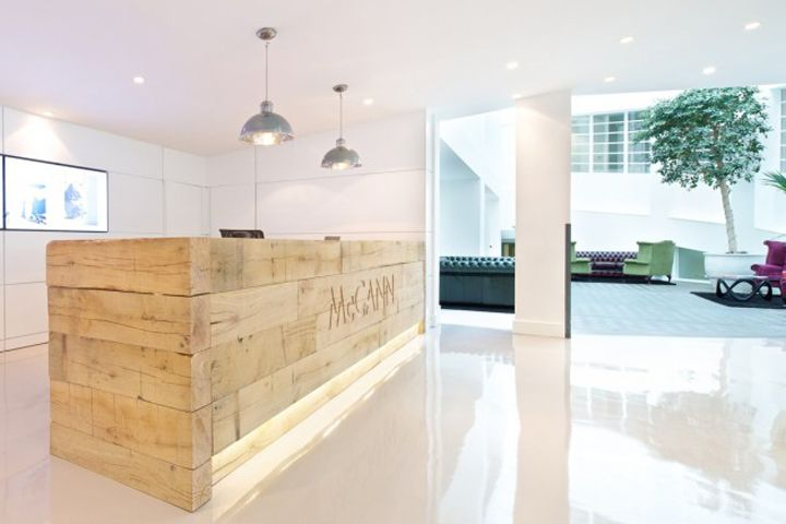 McCann Erickson's reception area and central breakout zone by Office Principles, London