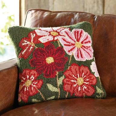 """Hand-hooked New Zealand wool brings the garden indoors with brilliantly blooming pink and red cosmos contrasted against a verdant green background. Designed by Vermont artist Laura Megroz. Cotton velveteen back. Polyester fiberfill. Zipper closure. Imported. Catalog exclusive. 18"""" SQ."""