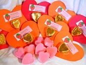 Home-made valentines... great for your child's classroom, or activity group. A fun project that you can both do together. It's easy and the kids will love it! Supplies you will need: Construction Paper, Scotch Tape, Foil, Labels or a Pen, Scissors, Silicone Soap or Candy Mold, White Melt-n-pour Soap Base, Red Food Color, Liquid Scent for Soap (I use strawberry). Instructions:  Melt 1 pound of white soap base in a double boiler, then take off of heat, and add 4 or 5 drops of red food…