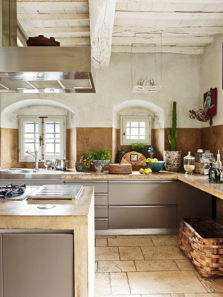 modern meets tuscan country! Love this eclectic mix of styles, especially the warm modern cabinetry, the weathered ceiling and the humungous basket