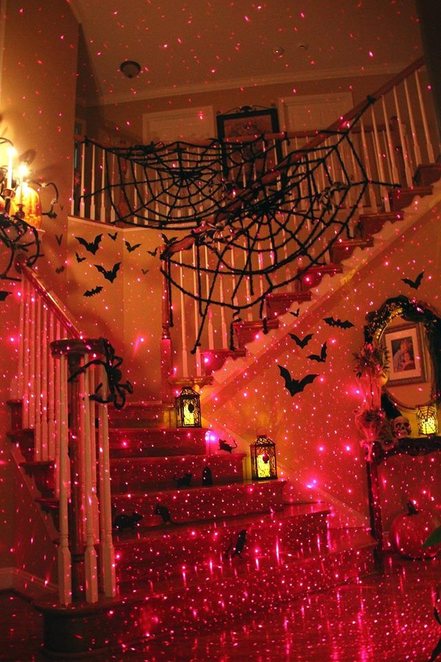 the sparkly lights make this halloween staircase more fun than spooky