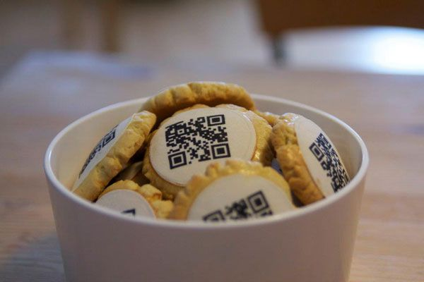 German food company comes up with cookies featuring QR codes printed on edible paper. The codes can be scanned to open a link to a web site, a love note, or even a party invite. Cool!