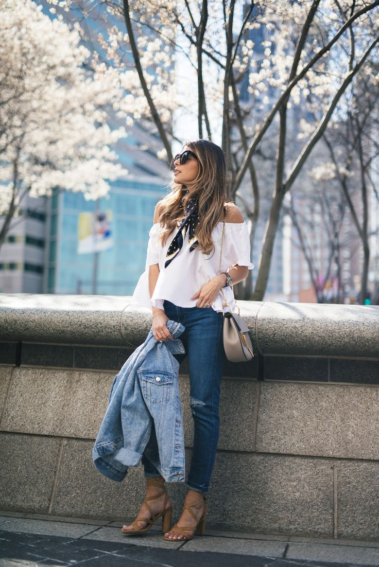 Off the shoulder tops are in this season! Wear a simple white number with a cute neck scarf like this one for an awesome spring style! Via Pam Hetlinger. Top: Mango, Jeans: Topshop, Shoes: Nordstrom.
