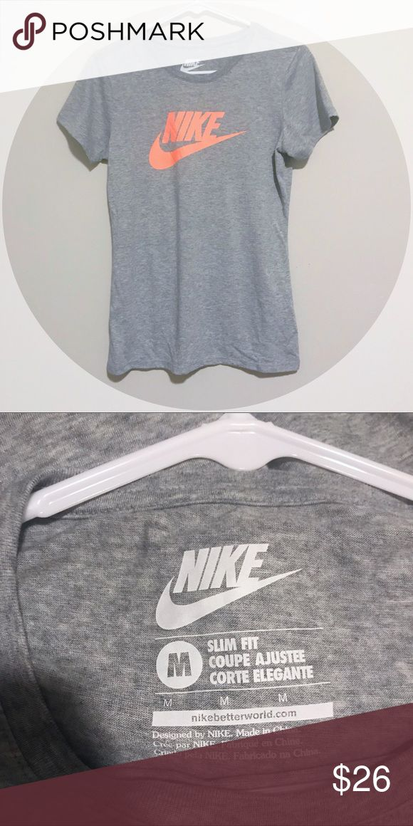 Grey Nike Swish Short Sleeve Top This fun and flattering Nike top is so soft! It has a slim fit and a pink orange Nike logo! The shirt is a light heathered grey. Size medium. Nike Tops Tees - Short Sleeve