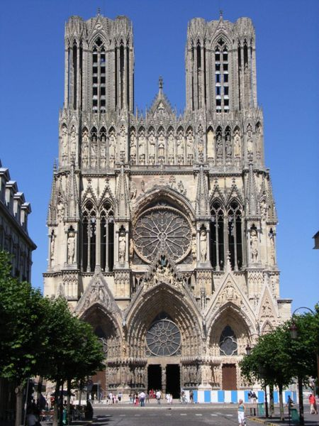 Reims Cathedral in Reims, France is a good example of French Gothic incorporating the rose window (located in the center of the cathedral). (Source)