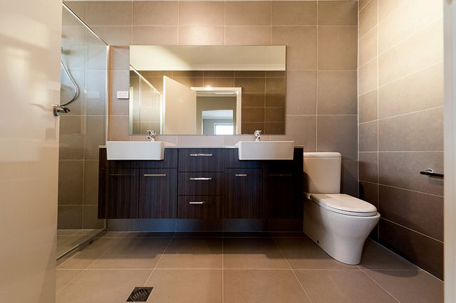 Warm toned tiles teamed with timber grain is always nice