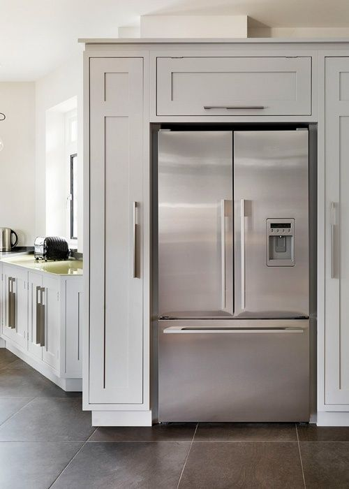 Pantry Cabinets around Refrigerator  Cabinets build around a white refrigerator DONT LIKE THE