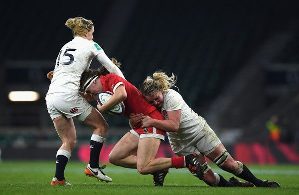 Karen Paquin of Canada is tackled Danielle Waterman of England (L) and Alex Matthews of England (R) during the Old Mutual Wealth Series Women's match between England and Canada at Twickenham Stadium on November 26, 2016 in London, England.