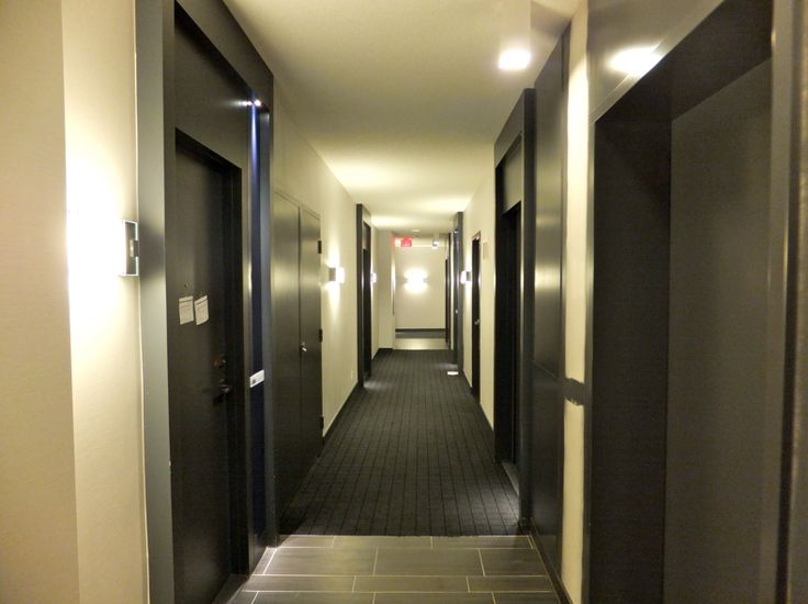 Condminium hallways partially completed building for Apartment hall design