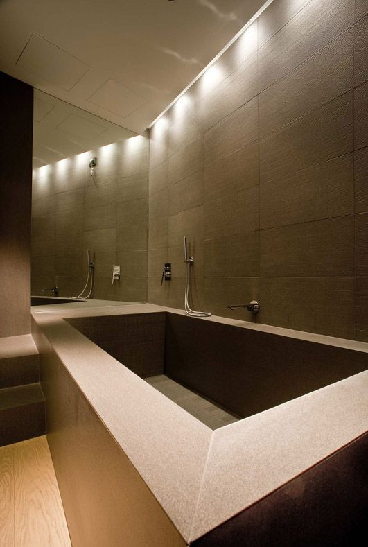 Tile cladded bathtub, created using 3mm thick slim porcelain from LEA Ceramiche. This slim porcelain allows a range of applications that might not otherwise be possible without its thinness, lightness and flexibility. A speciaity of Signorino Tile Gallery