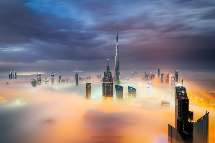 The Journey of Fog - There is one shot that everyone wants to have of Dubai and thats a shot of the city covered in thick fog . Its very rare to see dense fog in Dubai and when it comes into the city from the desert you have to be in the right place at the right time which most of the times is the early morning hours. I was chasing this shot for two years and today finally the weather gods were kind enough to give me this great fog but not only that , clouds were forming aswell which is a…