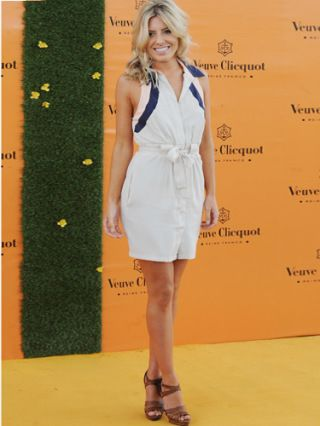 Does Mollie King ever get it wrong? Attending the Polo, The Saturday singer looked sexy yet sophisticated in this neutral playsuit with classic brown peep toe heels. Even with no accessories she still looks fab...