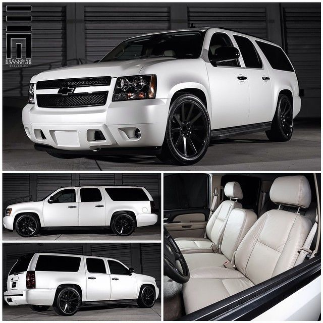 "Chevrolet Suburban customized with a complete satin pearl white exterior wrap with gloss black accents, smoked lights, lowered on gloss black painted 22"" @DubWheels , with a complete new tan leather interior! #ExclusiveMotoring #Miami"